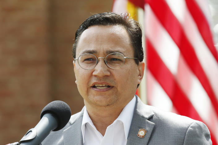 """FILE - In this Aug. 22, 2019 file photo, Cherokee Nation Principal Chief Chuck Hoskin Jr., speaks during a news conference in Tahlequah, Okla. The Navajo Nation has by far the largest land mass of any Native American tribe in the country. Now, it's boasting the largest enrolled population, too. Hoskin said the higher enrollment figure from the Navajo Nation government shows Natives are strong and an important force for economies, education and environment. """"It's truly a positive anytime our citizenship grows and thrives,"""" he said in a statement. (AP Photo/Sue Ogrocki, File)"""