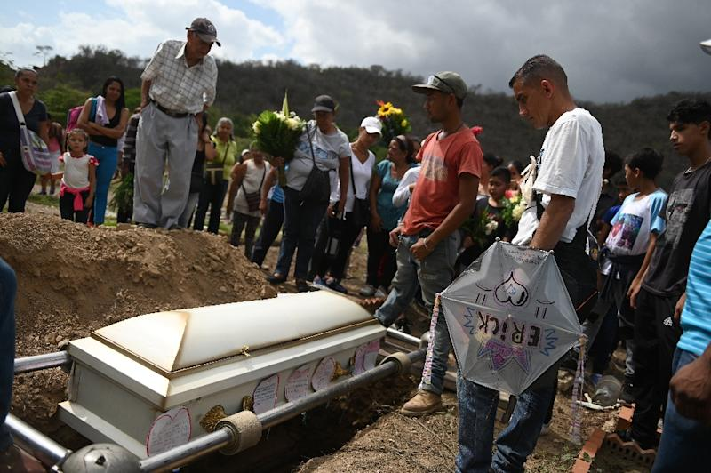 Gilberto Altuve had to rely on donations to pay for his son Erick's coffin (AFP Photo/Marvin RECINOS)