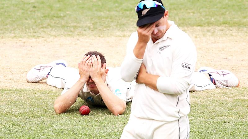 Todd Astle and Tom Latham, pictured here reacting to the shocking dropped catch.