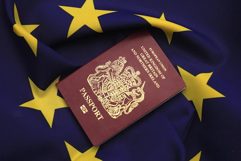 De La Rue profit hit as drops blue British passport bid