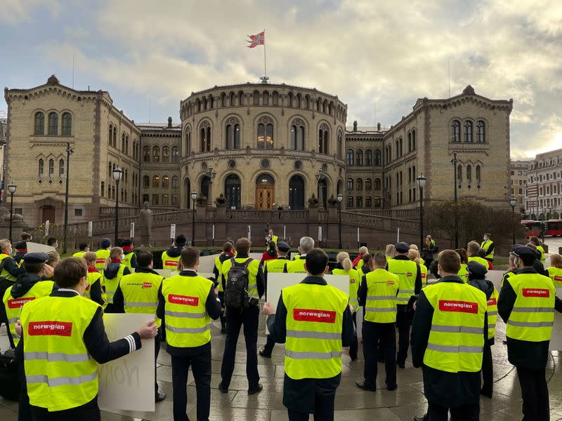 Norwegian Air crew staff demonstrate in front of the Norwegian Parliament in Oslo