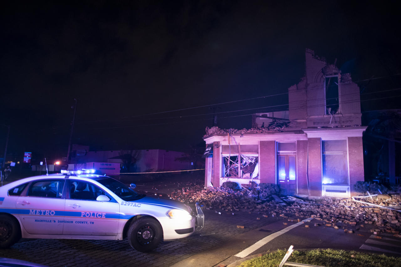 NASHVILLE, TN - MARCH 03:  Emergency crews work near a damaged business at Jefferson St. and Seventh Ave. N. on March 3, 2020 in Nashville, Tennessee. A tornado passed through Nashville just after midnight leaving a wake of damage in its path. (Photo by Brett Carlsen/Getty Images)