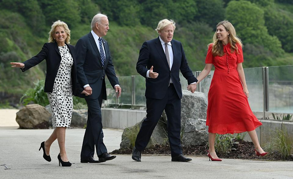 President Joe Biden and first lady Jill Biden meet Prime Minister Boris Johnson and his wife Carrie Johnson prior to a bilateral meeting, at Carbis Bay, Cornwall in southwestern England on June 10, 2021, ahead of a G7 summit.