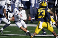 Penn State wide receiver Parker Washington (3) looks for running room as Michigan linebacker Michael Barrett (23) closes in during the first half of an NCAA college football game, Saturday, Nov. 28, 2020, in Ann Arbor, Mich. (AP Photo/Carlos Osorio)