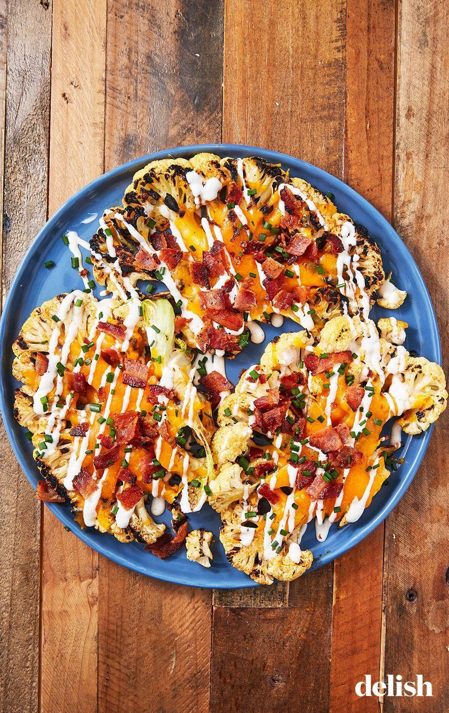 "<p>Low carb, BIG flavor.</p><p>Get the recipe from <a href=""https://www.delish.com/cooking/recipe-ideas/recipes/a54879/loaded-grilled-cauliflower-recipe/"" rel=""nofollow noopener"" target=""_blank"" data-ylk=""slk:Delish"" class=""link rapid-noclick-resp"">Delish</a>.</p>"