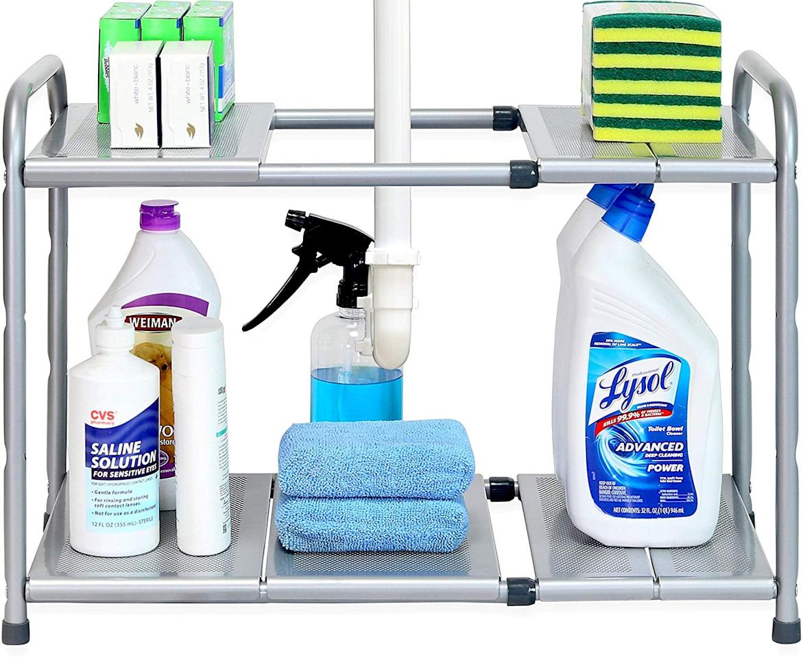 """<p>These <a href=""""https://www.popsugar.com/buy/SimpleHouseware-Under-Sink-2-Tier-Expandable-Shelf-556260?p_name=SimpleHouseware%20Under%20Sink%202%20Tier%20Expandable%20Shelf&retailer=amazon.com&pid=556260&price=20&evar1=casa%3Aus&evar9=46363853&evar98=https%3A%2F%2Fwww.popsugar.com%2Fhome%2Fphoto-gallery%2F46363853%2Fimage%2F46363937%2FSimpleHouseware-Under-Sink-2-Tier-Expandable-Shelf&list1=shopping%2Corganization%2Cproducts%20under%20%2425%2Chome%20organization%2Chome%20shopping&prop13=api&pdata=1"""" rel=""""nofollow"""" data-shoppable-link=""""1"""" target=""""_blank"""" class=""""ga-track"""" data-ga-category=""""Related"""" data-ga-label=""""https://www.amazon.com/dp/B01LWX3P9O/ref=twister_B077LDBQ67?_encoding=UTF8&amp;psc=1"""" data-ga-action=""""In-Line Links"""">SimpleHouseware Under Sink 2 Tier Expandable Shelf</a> ($20) are adjustable and expandable, so they perfectly fit in your space.</p>"""