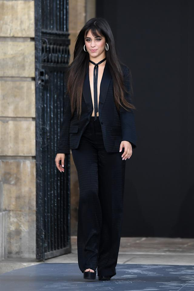 Participating in Paris Fashion Week, Camila worked the runway in a black suit.