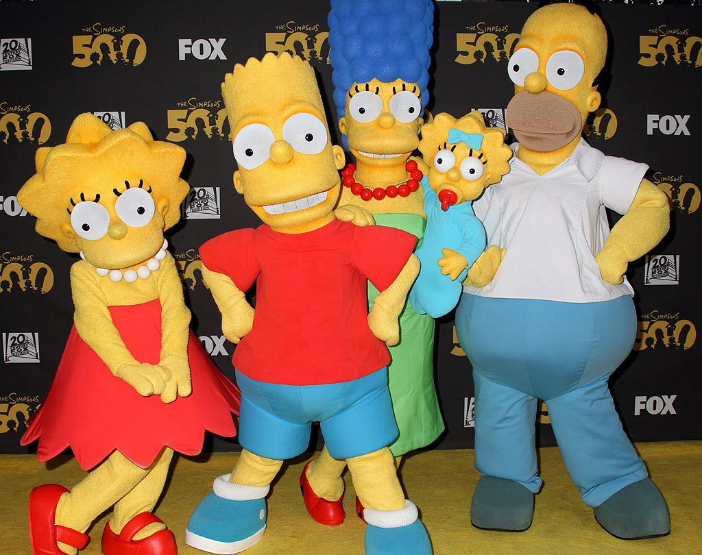 """Five hundred episodes and they haven't aged a bit! The """"cast"""" of the long-running animated Fox comedy """"The Simpsons"""" celebrated the milestone at the Roosevelt Hotel in Hollywood on Monday. It was a busy few days for the show as its creator, Matt Groening, was honored with a star on the Hollywood Walk of Fame later in the week. (2/13/2012)"""