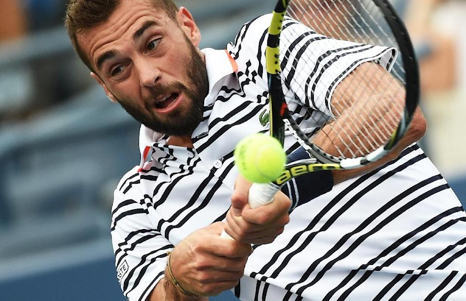 Benoit Paire returns a shot to Kei Nishikori during their US Open match in New York on August 31, 2015 (AFP Photo/Jewel Samad)