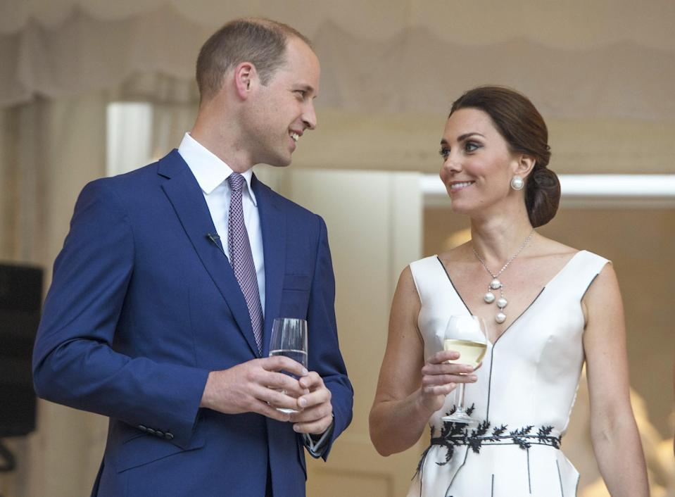 <p><b><b><b>Kate and William ended their first day in Warsaw, Poland, with a couple of drinks at a garden party. The Duchess joked about expanding her family when gifted with a toy for a newborn.<em> [Photo: Getty]</em> </b></b></b></p>