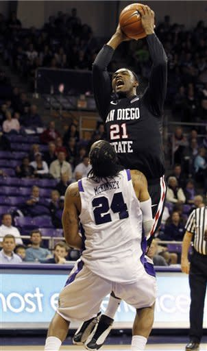San Diego State guard Jamal Franklin (21) shoots over TCU forward Adrick McKinney (24) during the first half of an NCAA college basketball game on Saturday, March 3, 2012, in Fort Worth, Texas. (AP Photo/Sharon Ellman)