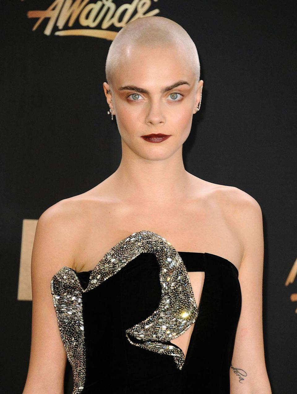 """<p>Cara Delevingne proved she was committed to her role in <em>Life in a Year</em> when she debuted a shiny head in 2017. The model/actress would keep her hair <a href=""""https://www.harpersbazaar.com/uk/beauty/hair/news/a42775/cara-delevingne-explains-why-she-really-cut-off-her-hair/"""" rel=""""nofollow noopener"""" target=""""_blank"""" data-ylk=""""slk:closely cropped"""" class=""""link rapid-noclick-resp"""">closely cropped</a> for a short period after the filming the drama, in which she played a woman with cancer left with one year to live. </p>"""