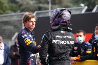 CORRECTS PILOT'S NAME ON THE LEFT - First placed Red Bull's Max Verstappen, left, greets second placed Mercedes Lewis Hamilton at the end of the Emilia Romagna Formula One Grand Prix, at the Imola racetrack, Italy, Sunday, April 18, 2021. (Bryn Lennon/ Pool Via AP)