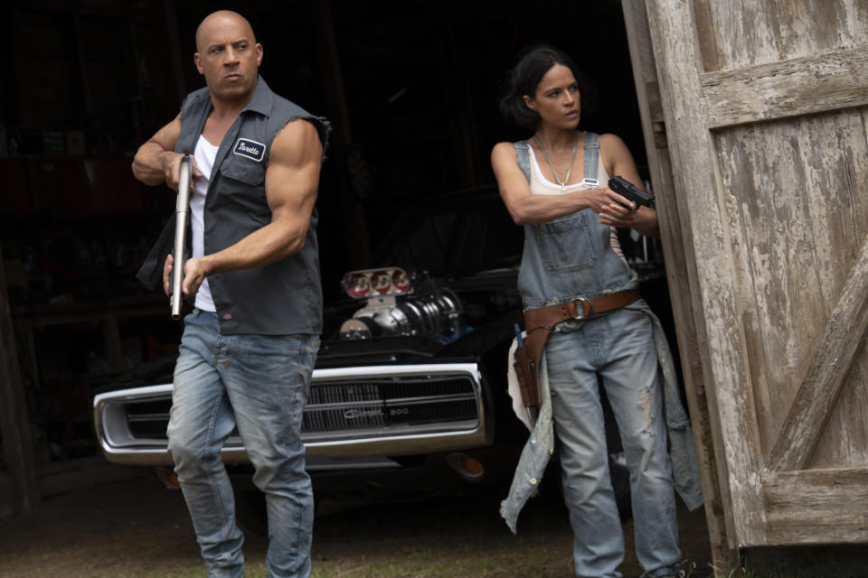 """This image released by Universal Pictures shows Vin Diesel, left, and Michelle Rodriguez in a scene from """"F9: The Fast Saga."""" (Giles Keyte/Universal Pictures via AP)"""