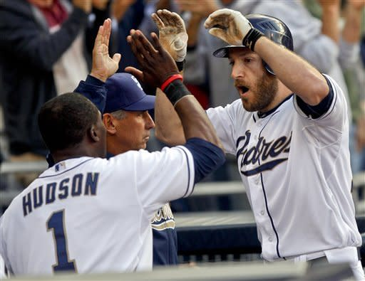 San Diego Padres' Chris Denorfia, right, celebrates with teammates after his two-run home run in the eighth inning against the Arizona Diamondbacks in a baseball game won by the Padres 2-1 on Wednesday, April 11, 2012, in San Diego. (AP Photo/Lenny Ignelzi)