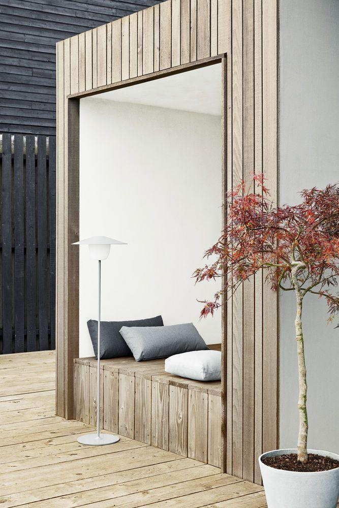 """<p>The desire to curl up on a window seat indoors and gaze upon the world outside has seen a boom in cantilevered windows recently. This idea turns the concept on its head, allowing you to be in the garden and free among the elements, while still being protected from them. Different widths of cladding on this simple shelter echo the decking, while the white interior reflects the light. 'Ani' floor lamp by <a href=""""https://de.blomus.com/en/"""" rel=""""nofollow noopener"""" target=""""_blank"""" data-ylk=""""slk:Blomus"""" class=""""link rapid-noclick-resp"""">Blomus</a>.</p>"""