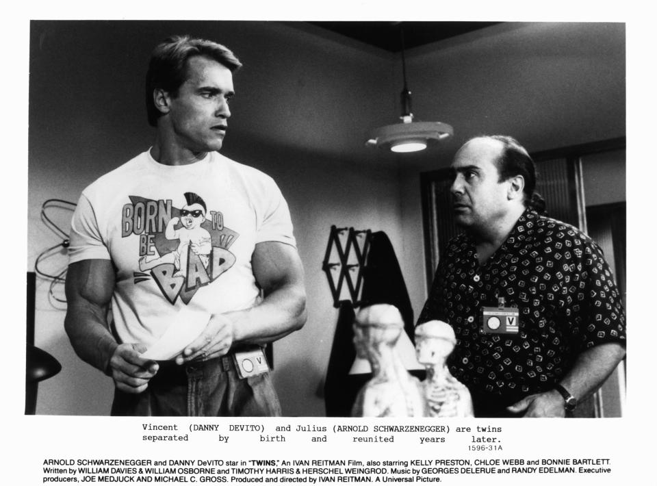 Arnold Schwarzenegger looking back at Danny DeVito in a scene from the film 'Twins', 1988. (Photo by Universal/Getty Images)
