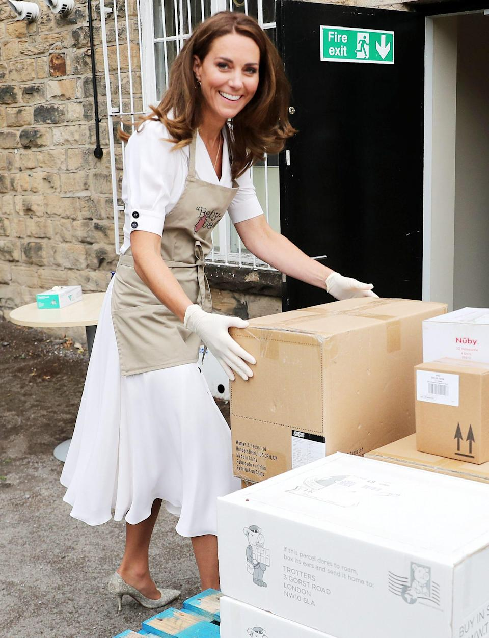 """<p>Kate Middleton helps unload supplies during a <a href=""""https://people.com/royals/kate-middleton-visits-baby-bank/"""" rel=""""nofollow noopener"""" target=""""_blank"""" data-ylk=""""slk:visit to Baby Basics"""" class=""""link rapid-noclick-resp"""">visit to Baby Basics</a>, a charity that acts as a food bank for baby supplies, in Sheffield, England, on Tuesday. </p>"""