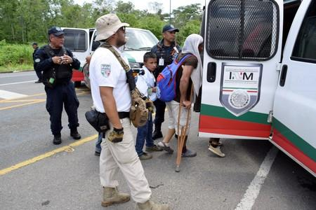 Migrants are seen boarding a van of the National Migration Institute (INM) after being detained during a joint operation by the Mexican government to stop a caravan of Central American migrants on their way to the U.S., at Metapa de Dominguez