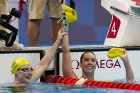Emma Mckeon, of Australia, right, celebrates with teammate Cate Campbell after winning the women's 100-meter freestyle final at the 2020 Summer Olympics, Friday, July 30, 2021, in Tokyo, Japan. (AP Photo/Jae C. Hong)