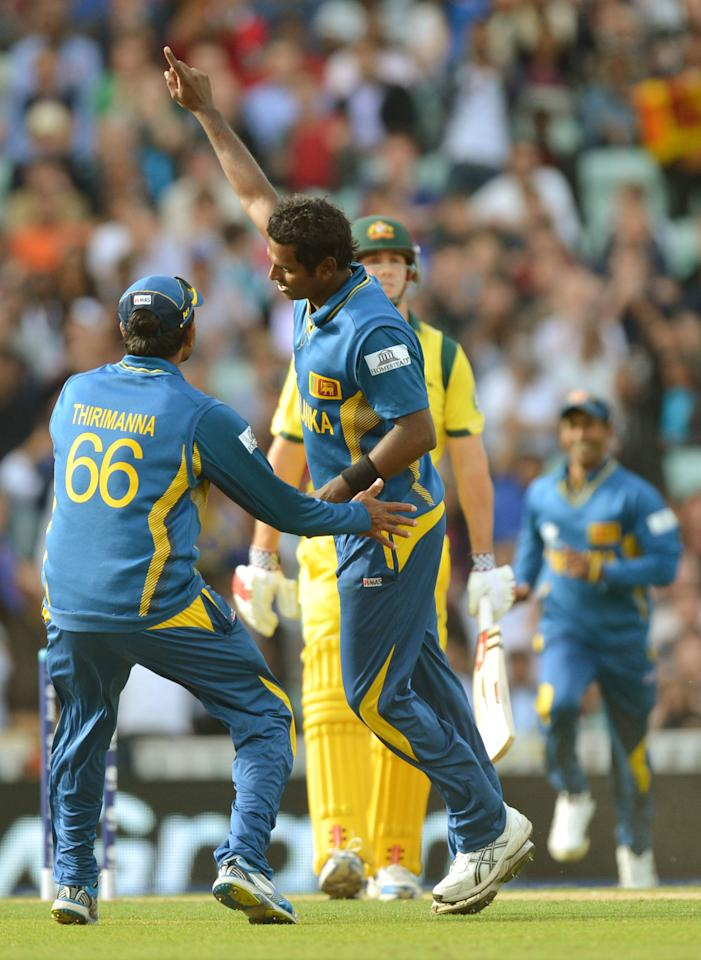 Sri Lanka's captain Angelo Matthews (centre) celebrates bowling out Australia's Mitchell Marsh (second right) during the ICC Champions Trophy match at The Oval, London.