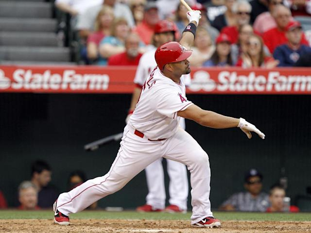 Los Angeles Angels' Albert Pujols watches his double against the Kansas City Royals in the fifth inning of a baseball game Saturday, May 24, 2014, in Anaheim, Calif. Pujol's double is the 2,400th hit of his career. (AP Photo/Alex Gallardo)