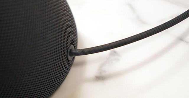 The HomePod's cord is wrapped in fabric, too.