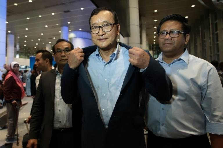 Cambodia's exiled opposition leader Sam Rainsy arrived in Malaysia after being barred in Paris from getting on a flight to Thailand
