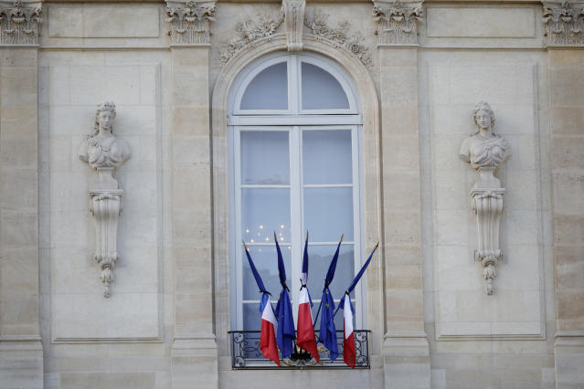 French and European flags are at half-mast to pay homage to former French President Jacques Chirac, Friday Sept. 27, 2019 at the Elysee Palace in Paris. Jacques Chirac's death on Thursday at age 86 marked a nation feeling sorely in need of a leader with Chirac's staying power. (AP Photo/Kamil Zihnioglu)