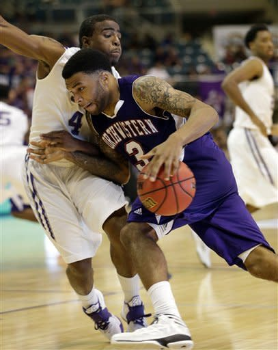 Northwestern State's Shamir Davis (3) drives toward the basket as Stephen F. Austin's Hal Bateman (4) defends during the second half of the Southland Conference championship basketball game on Saturday, March 16, 2013, in Katy, Texas. Northwestern State defeated Stephen F. Austin 68-66. (AP Photo/David J. Phillip)