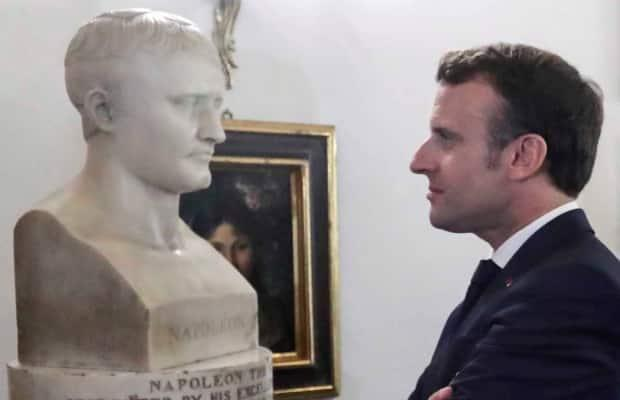 While attending a summit in Valletta, Malta, on June 14, 2019, French President Emmanuel Macron looks at a bust of Napoleon in the room where he lived during his brief stay on the Mediterranean island in 1789.