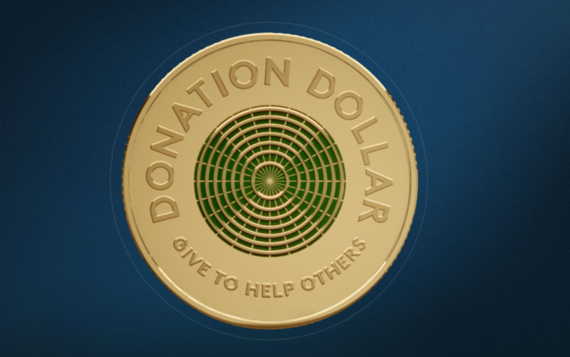 The Donation Dollar features a green and gold ripple design. Image: Royal Australian Mint.