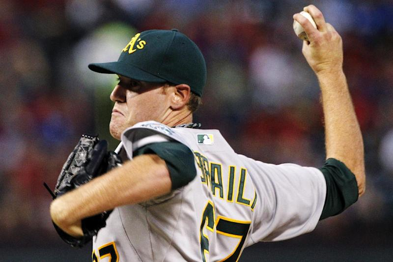 Oakland Athletics starting pitcher Dan Straily (67) delivers to the Texas Rangers in the first inning of a baseball game, Monday, Sept. 24, 2012, in Arlington, Texas. (AP Photo/Tony Gutierrez)