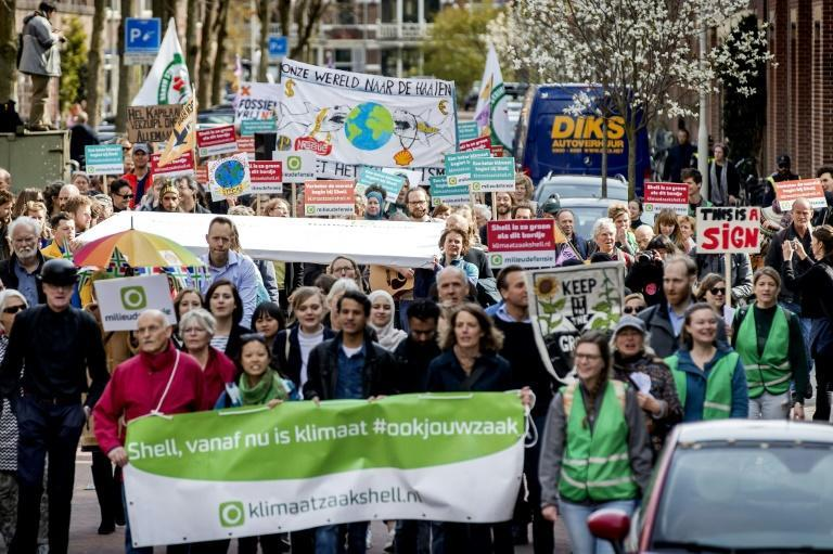 Dozens of climate marchers handed in the lawsuit to Shell's headquarters in the Netherlands in in April 2019