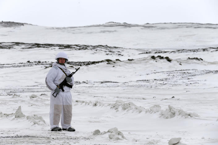 A Russian soldier stands guard as the Bastion anti-ship missile systems take positions on the Alexandra Land island near Nagurskoye, Russia, Monday, May 17, 2021. Once a desolate home mostly to polar bears, Russia's northernmost military outpost is bristling with missiles and radar and its extended runway can handle all types of aircraft, including nuclear-capable strategic bombers, projecting Moscow's power and influence across the Arctic amid intensifying international competition for the region's vast resources. (AP Photo/Alexander Zemlianichenko)