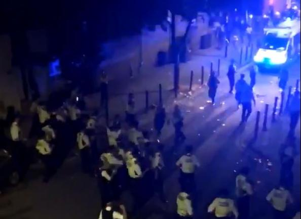 Fifteen police officers were injured in violent clashes in Brixton. (PA)