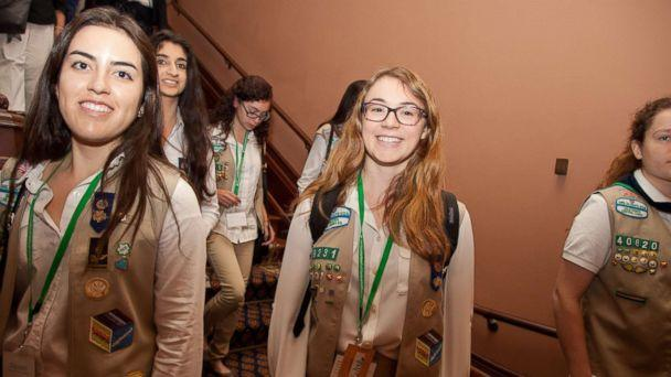 PHOTO: California Girl Scout Gold Award recipients Daniela Castro (L) and Sarah Gillespie (center) of Girl Scouts of Greater Los Angeles walk the halls of the State Capitol with their fellow awardees, on June 23, 2016, in Sacramento, Calif. (Kelly Sullivan/Getty Images for Girl Scouts)
