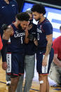 Connecticut's R.J. Cole (1) is helped past Jalen Gaffney (0) after he was injured during the second half of the team's NCAA college basketball game against Creighton in the semifinals in the Big East men's tournament Friday, March 12, 2021, in New York. (AP Photo/Frank Franklin II)