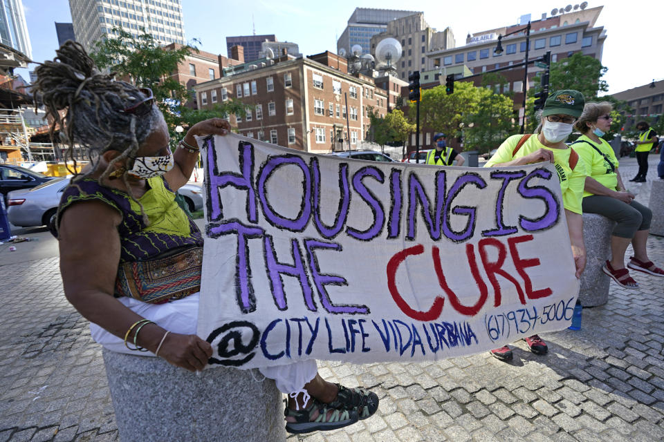 """In this June 9, 2021, photo, people hold a sign during a rally in Boston protesting housing eviction. The Biden administration on Thursday, July 29, 2021, announced it will allow a nationwide ban on evictions to expire Saturday, July 31, 2021. The White House said President Joe Biden would have liked to extend the federal eviction moratorium due to spread of the highly contagious delta variant. Instead, Biden called on """"Congress to extend the eviction moratorium to protect such vulnerable renters and their families without delay.""""(AP Photo/Elise Amendola)"""