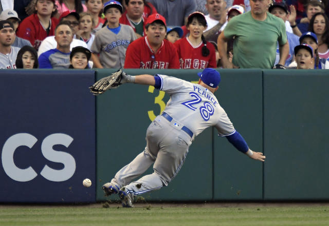 Toronto Blue Jays left fielder Steve Pearce slips as he tries to field an RBI double by Los Angeles Angels' Albert Pujols during the first inning of a baseball game Friday, June 22, 2018, in Anaheim, Calif. (AP Photo/Mark J. Terrill)