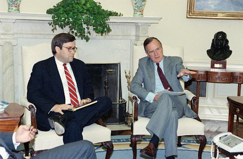 William Barr, left, is seen in 1992 with President George H.W. Bush when Barr was serving as U.S. attorney general. (Photo: ASSOCIATED PRESS)