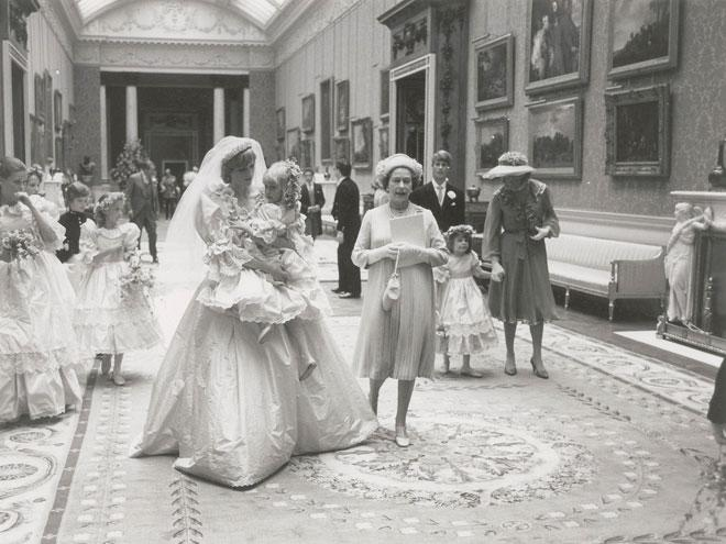 <p>In her arms, Diana cradles Clementine Hambro, who, at just 5 years old, was her youngest bridesmaid.</p>