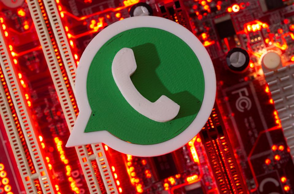 A 3D printed Whatsapp logo is placed on a computer motherboard in this illustration taken January 21, 2021. REUTERS/Ruvic data/Illustration