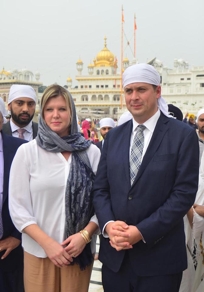 <p>Conservative Leader Andrew Scheer poses with his wife, Jill Scheer, at the Golden Temple in Amritsar, India, on Oct. 10, 2018. Photo from Getty Images. </p>