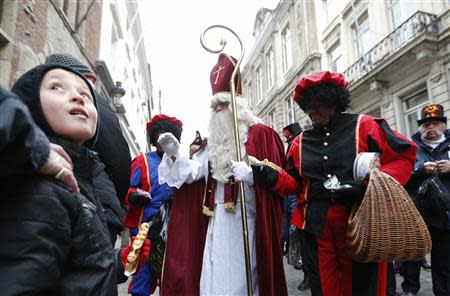 File photo of Saint Nicholas escorted by his assistants called Black Pete during a traditional parade in central Brussels
