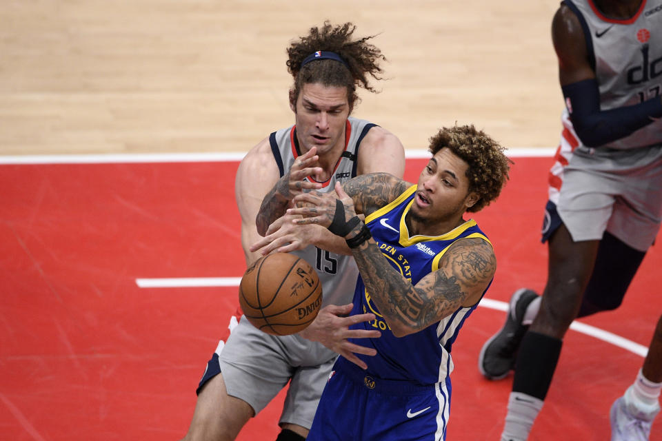 Golden State Warriors guard Kelly Oubre Jr., right, and Washington Wizards center Robin Lopez, left, battle for the ball during the second half of an NBA basketball game, Wednesday, April 21, 2021, in Washington. (AP Photo/Nick Wass)