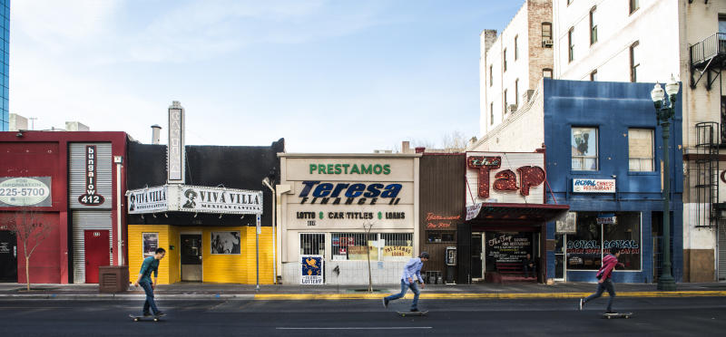 UNITED STATES - FEBRUARY 22: Skateboarders zip past a colorful row of small businesses in downtown El Paso, Texas (Photo by Carol M. Highsmith/Buyenlarge/Getty Images) (Buyenlarge via Getty Images)