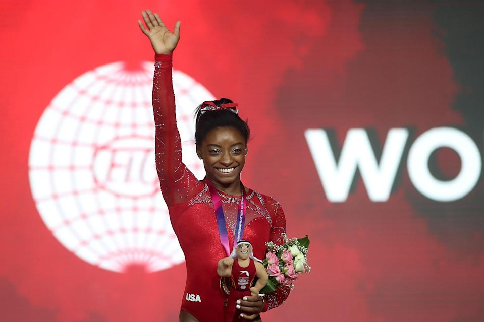"""<p>Despite leading Team USA to gold at the 2018 gymnastics world championships in Doha, <a href=""""https://www.popsugar.com/fitness/Simone-Biles-World-Championship-After-Kidney-Stone-2018-45428392"""" class=""""link rapid-noclick-resp"""" rel=""""nofollow noopener"""" target=""""_blank"""" data-ylk=""""slk:Simone was suffering severe pain from a kidney stone"""">Simone was suffering severe pain from a kidney stone</a>. Though she'd been admitted to the hospital before the meet, she'd left without passing the stone, which <a href=""""http://www.usatoday.com/story/sports/columnist/nancy-armour/2018/10/27/simone-biles-joins-mj-and-tiger-woods-iconic-performances/1790405002/"""" class=""""link rapid-noclick-resp"""" rel=""""nofollow noopener"""" target=""""_blank"""" data-ylk=""""slk:she lovingly nicknamed the &quot;Doha Pearl&quot;"""">she lovingly nicknamed the """"Doha Pearl""""</a> due to its size. She later joked to <strong>USA Today</strong>, """"I'm trying not to move every time I do something just in case [the stone] moves. Then I also hear roller coasters might help kidney stones, and I'm like my own roller coaster out there.""""</p>"""