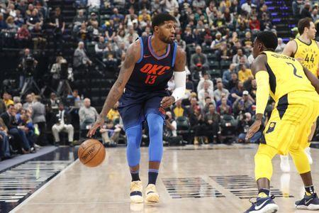 Dec 13, 2017; Indianapolis, IN, USA; Oklahoma City Thunder forward Paul George (13) dribbles the ball as Indiana Pacers guard Darren Collison (2) defends during the first quarter at Bankers Life Fieldhouse. Brian Spurlock-USA TODAY Sports