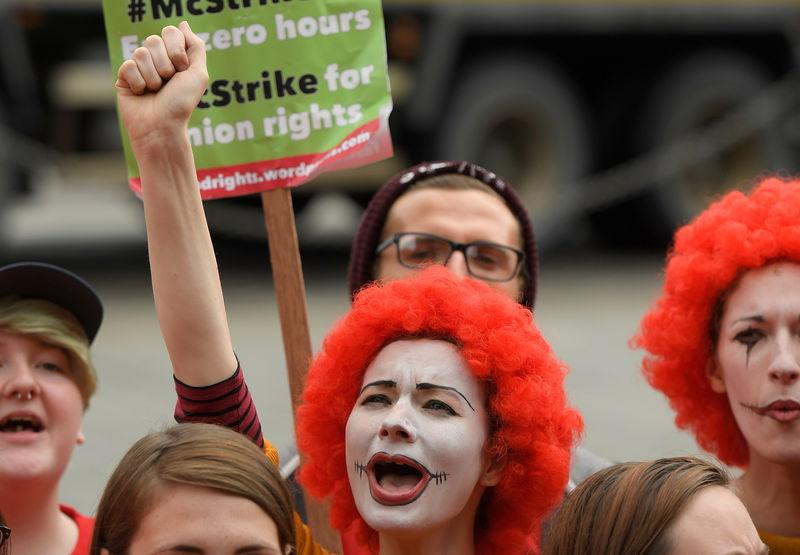 Protestors demonstrate in support of workers at British McDonalds restaurants striking in a protest over pay and other industrial relations issues, near the Houses of Parliament in London